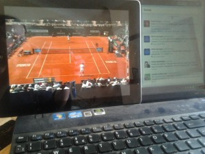 iPad propped on laptop